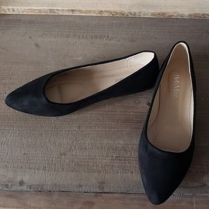 Black suede flat shoes